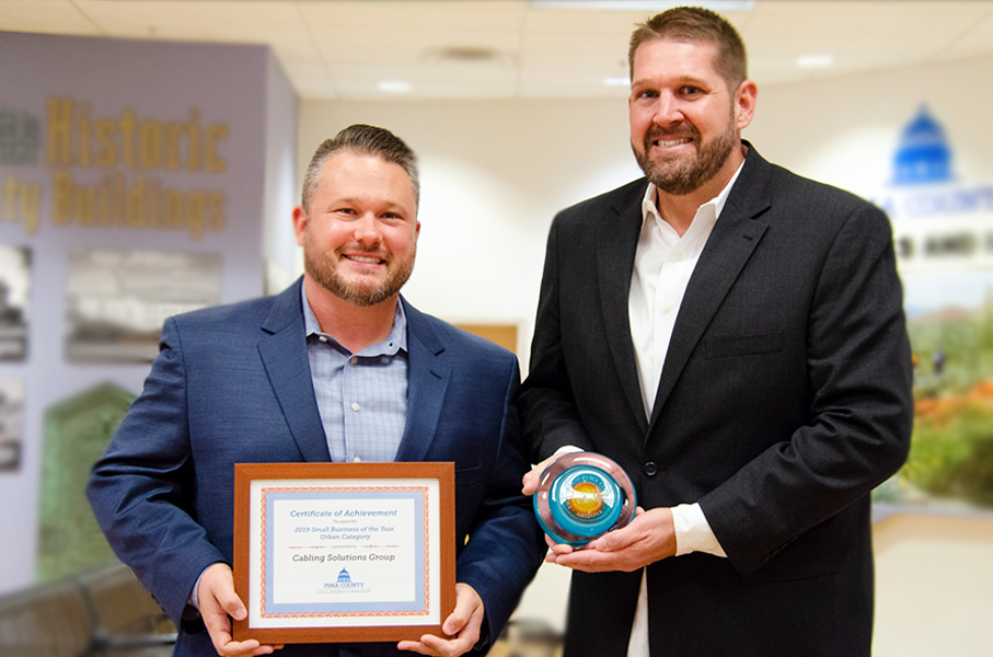 Brian Pessin and Brian Peircey Holding Small Business Awards
